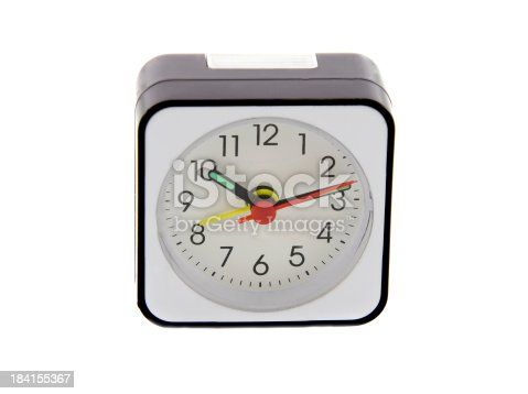 istock Modern alarm clock isolated over white. Time is 10.12 a.m. 184155367