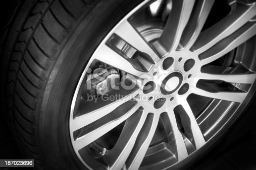 istock Modern alloy wheel with seven spokes on black 187023696