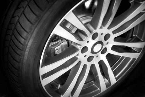 istock Modern alloy wheel with seven spokes on black 187023696