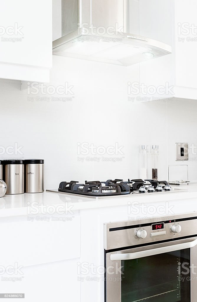 Modern, all-white, fitted kitchen stock photo