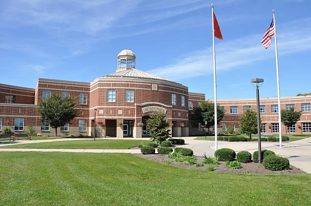 modern American high school exterior stock photo