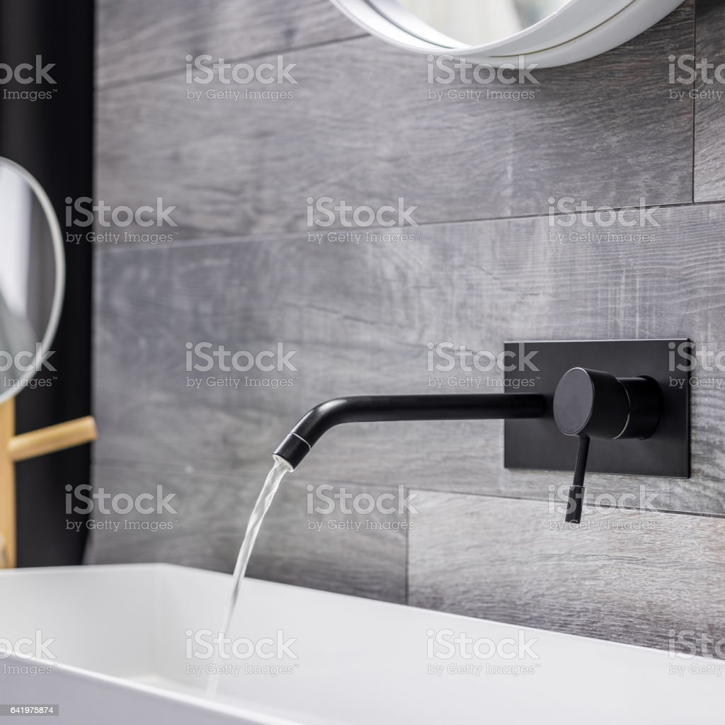 Modern and black bathroom tap stock photo