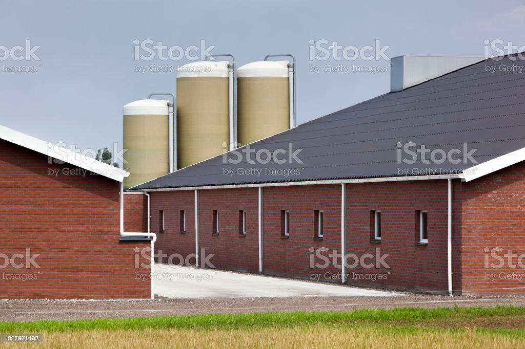 Modern and clean brick farm building stock photo