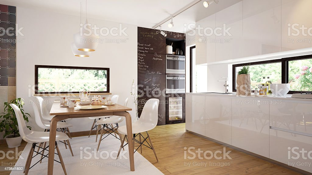 Modern and comfy kitchen and dining room interior stock photo
