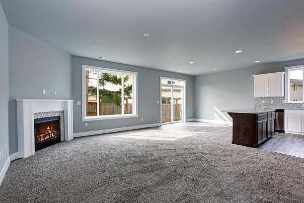 modern and completely gray interior of home. - tapijt stockfoto's en -beelden