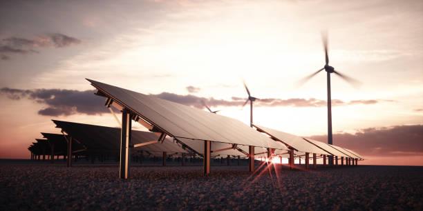 Modernos y futuristas estética negro paneles solares de gran central fotovoltaica aerogeneradores en fondo en la cálida luz del atardecer. Render 3D. - foto de stock