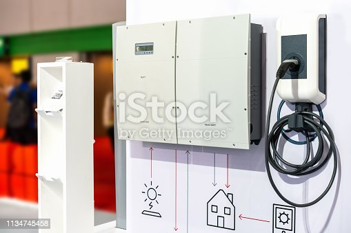 istock Modern and high technology of transportation electric vehicle charging (Ev) station with plug of power cable supply for Ev car or hybrid 1134745458