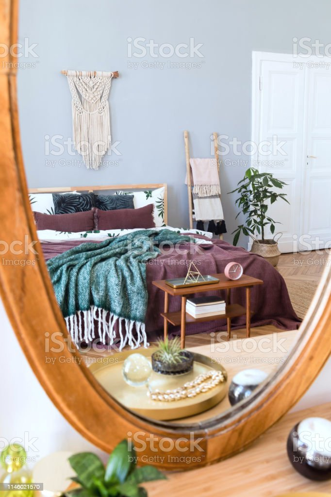 Stylish and luxury interior of bedroom with design furnitures and...