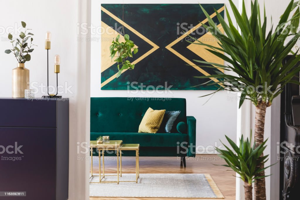 Picture of: Modern And Luxury Interior Of Living Room With Pomegranate Shelf Gold Coffee Table Velvet Sofa Tropical Plant And Elegant Accessories Design Paintings On The Wall Stylish Home Decor Template Stock Photo