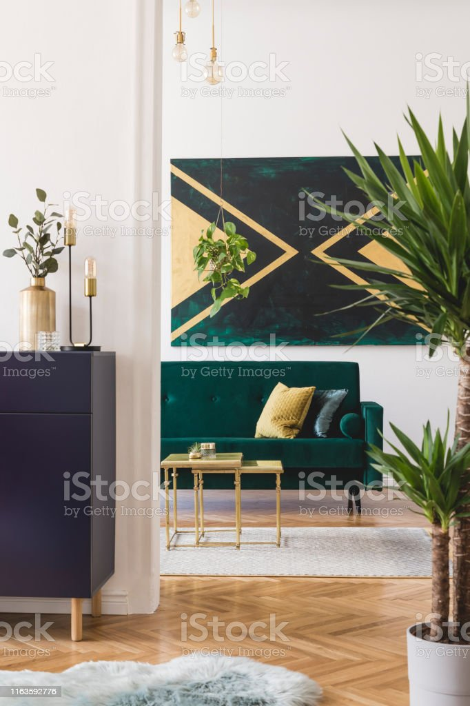 Modern And Luxury Interior Of Living Room With Shelf Gold