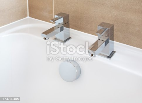 modern angular bath taps set on a white ceramic bath tub.Looking for a Bathroom image Then please see my other Bathrooms and related inages by clicking on the Lightbox link below...A>AA>A