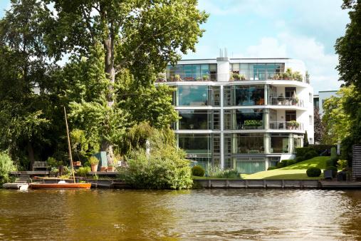 modern apartment building at alster lake, hamburg