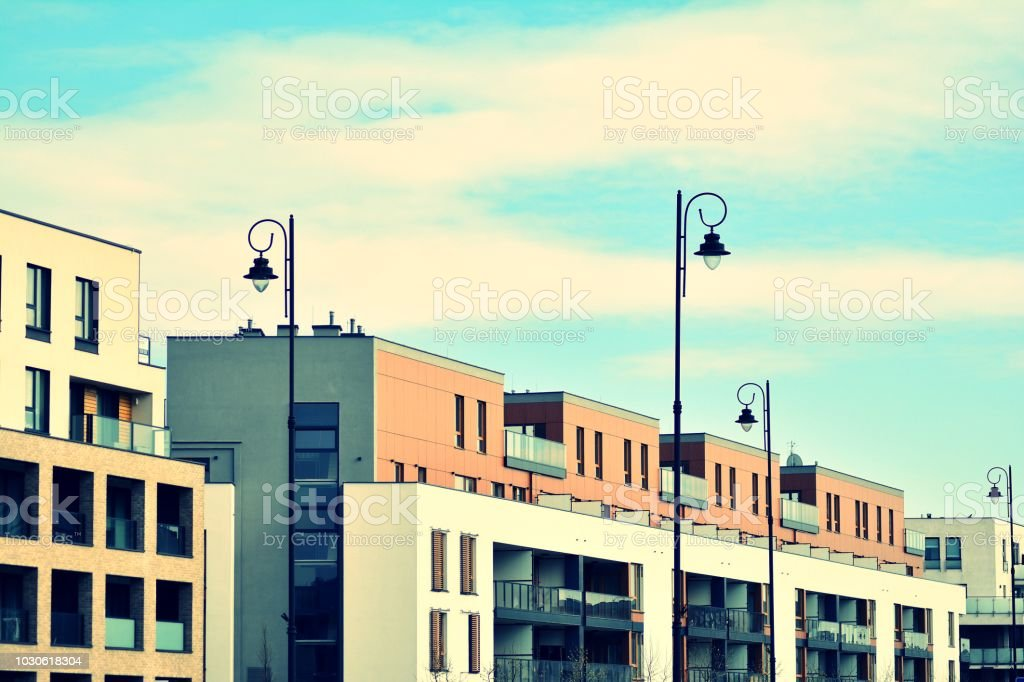 Modern apartment building exterior. Retro colors stylization stock photo