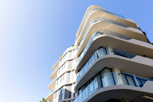 Modern apartment building, Sydney Australia, low angle view, blue sky background with copy space, full frame horizontal composition