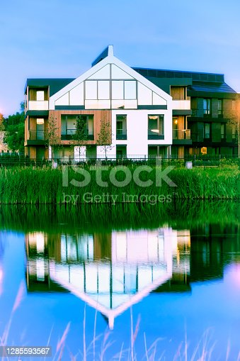 istock Modern apartment building on the canal 1285593567