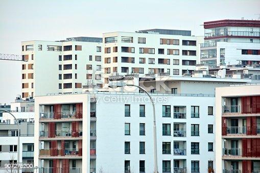 680603734 istock photo Modern apartment building 907275200