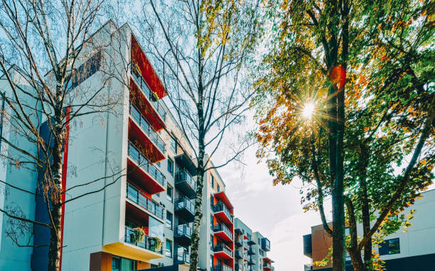 EU Modern apartment building real estate architecture outdoor sunset stock photo