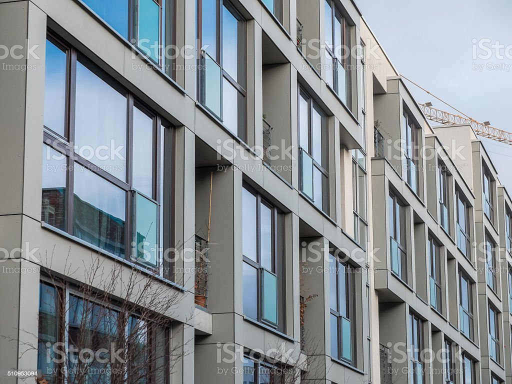 Modern Apartment Building With Large Windows Royalty Free Stock Photo