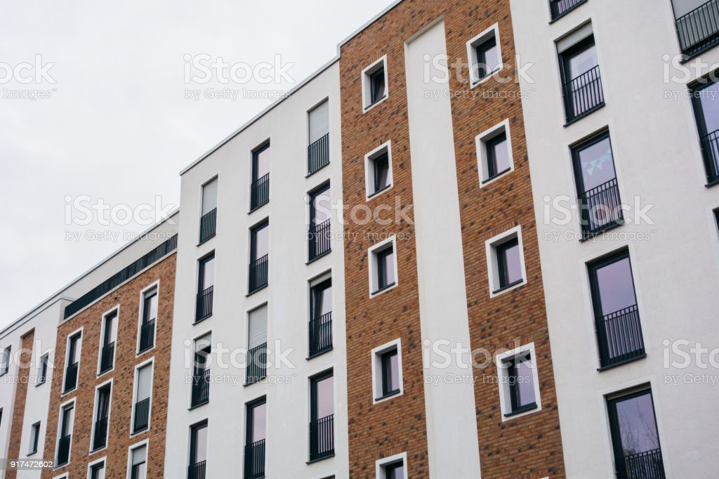 Modern Apartment Building With White And Brown Brick Facade Royalty Free  Stock Photo