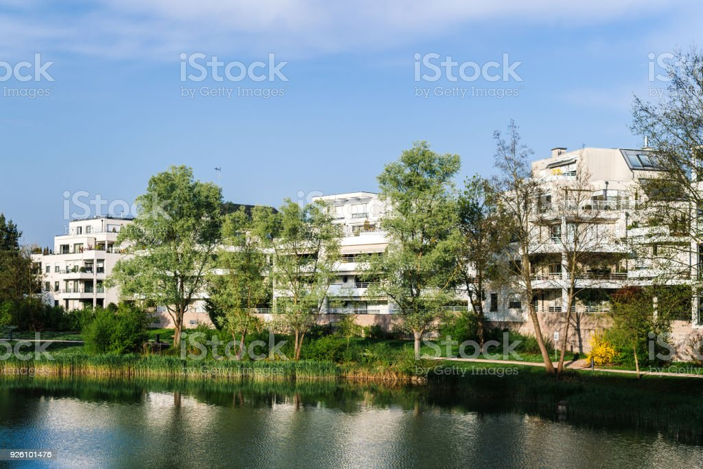 Modern apartment building with windows and balconies stock photo
