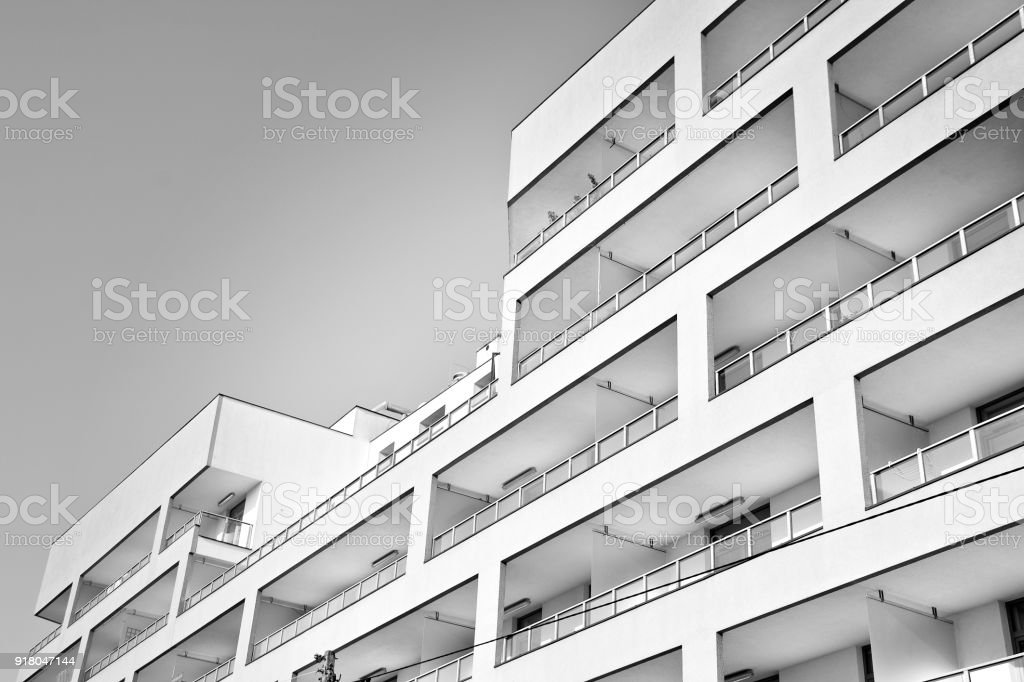 Modern Apartment Buildings. Facade Of A Modern Apartment Building. Black  And White. Royalty