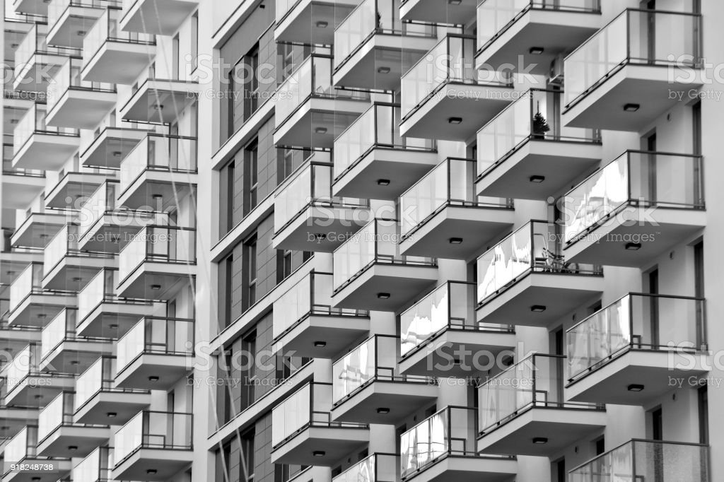 Modern apartment buildings. Facade of a modern apartment building. Black and white. stock photo