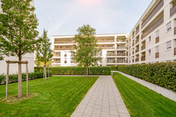 Modern apartment buildings in a green sustainable environment Modern apartment buildings in a green sustainable environment courtyard stock pictures, royalty-free photos & images