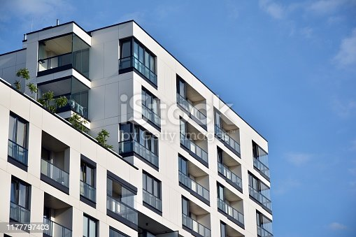 istock Modern apartment buildings on a sunny day with a blue sky. 1177797403