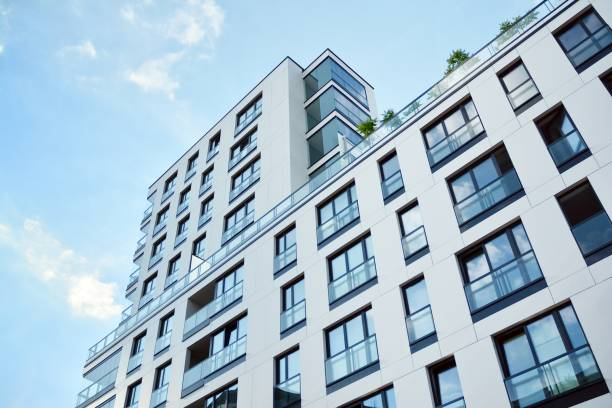 Modern apartment buildings on a sunny day with a blue sky. stock photo
