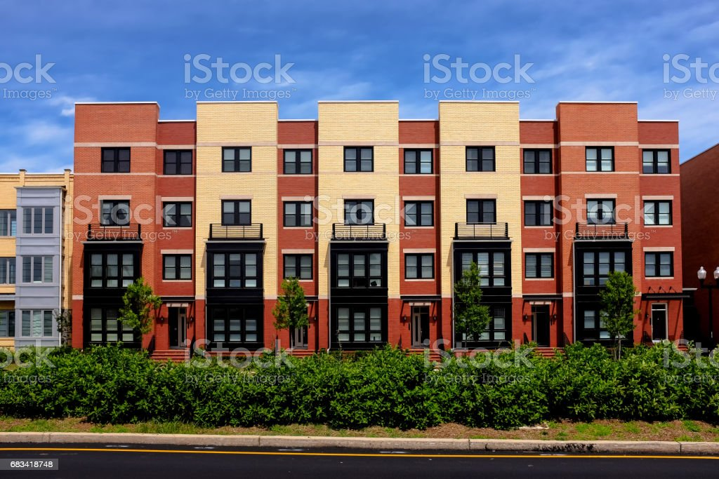 Modern apartment buildings on a sunny day with a blue sky stock photo