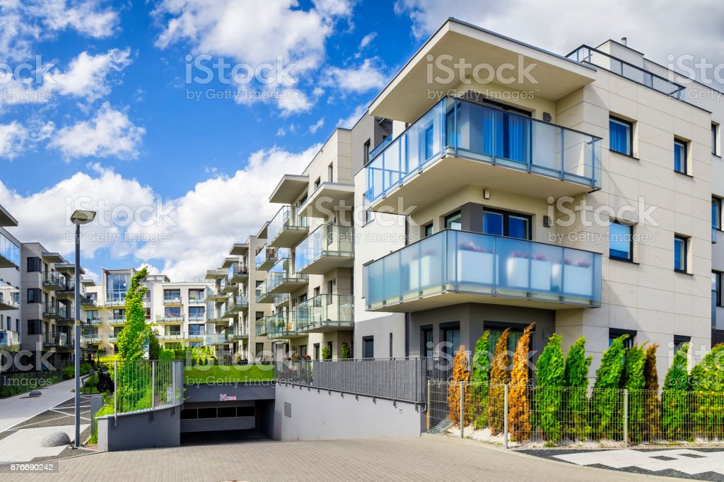 Modern apartment buildings with underground garage in a new housing...