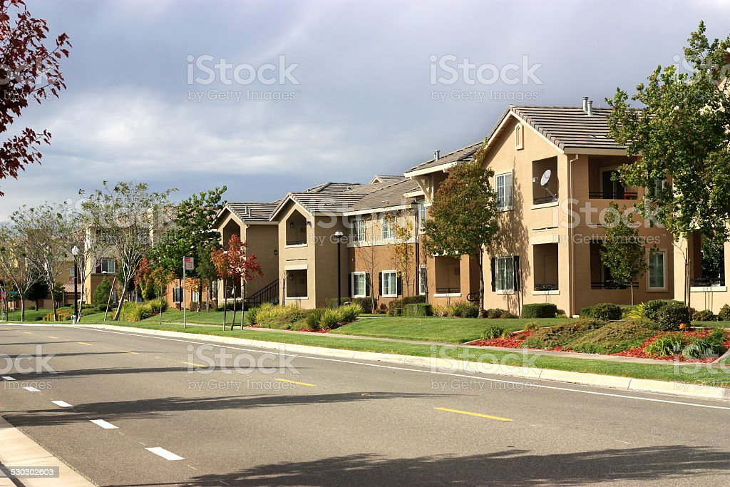 Modern apartment complex in suburban neighborhood stock photo