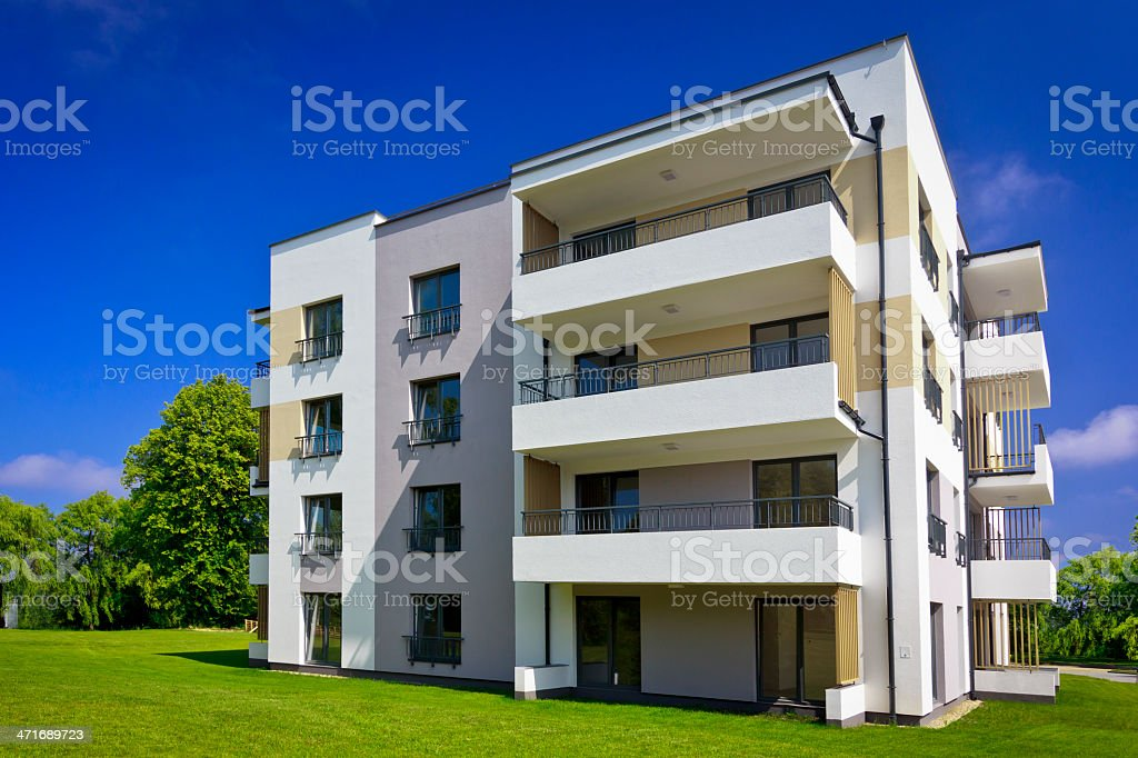 Modern apartment house in the park royalty-free stock photo