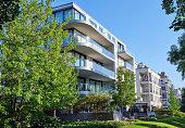 istock Modern apartment house with a green garden 1165639018