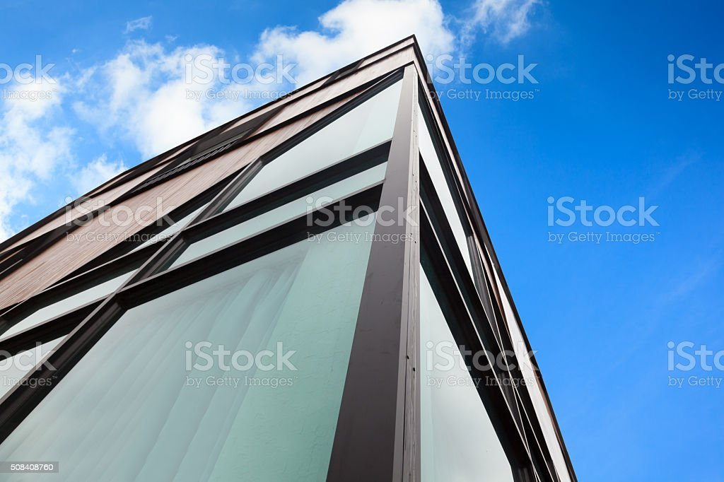 Modern apartment house with wood facade stock photo