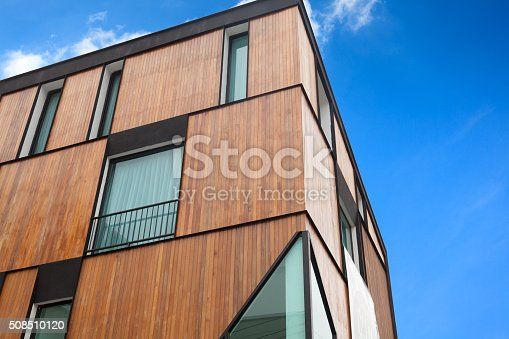 istock Modern apartment house with wood facade 508510120