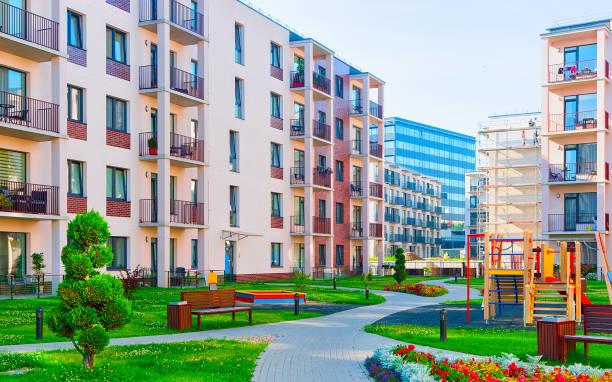 Modern apartment residential building children playground reflex stock photo