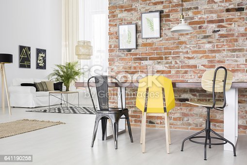 660325278istockphoto Modern apartment with brick wall 641190258