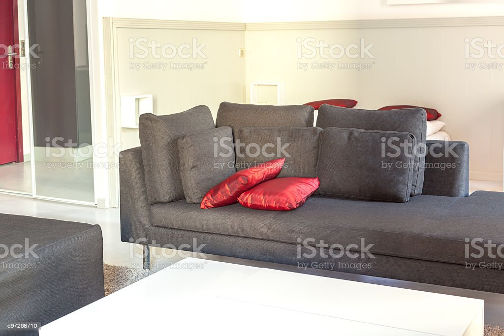 Modern apartments cozy furniture: a sofa with pillows royalty-free stock photo