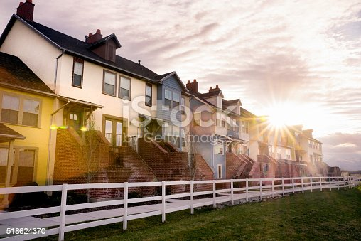 istock Modern Apartments under a beautiful cloudscape 518624370