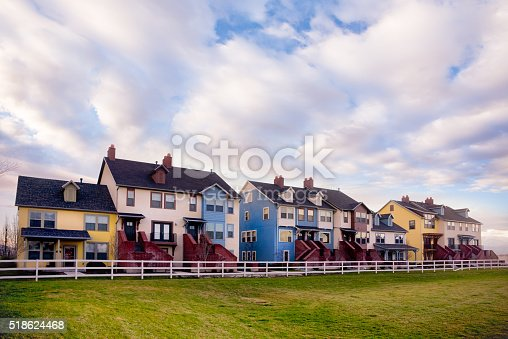 istock Modern Apartments under a beautiful cloudscape 518624468
