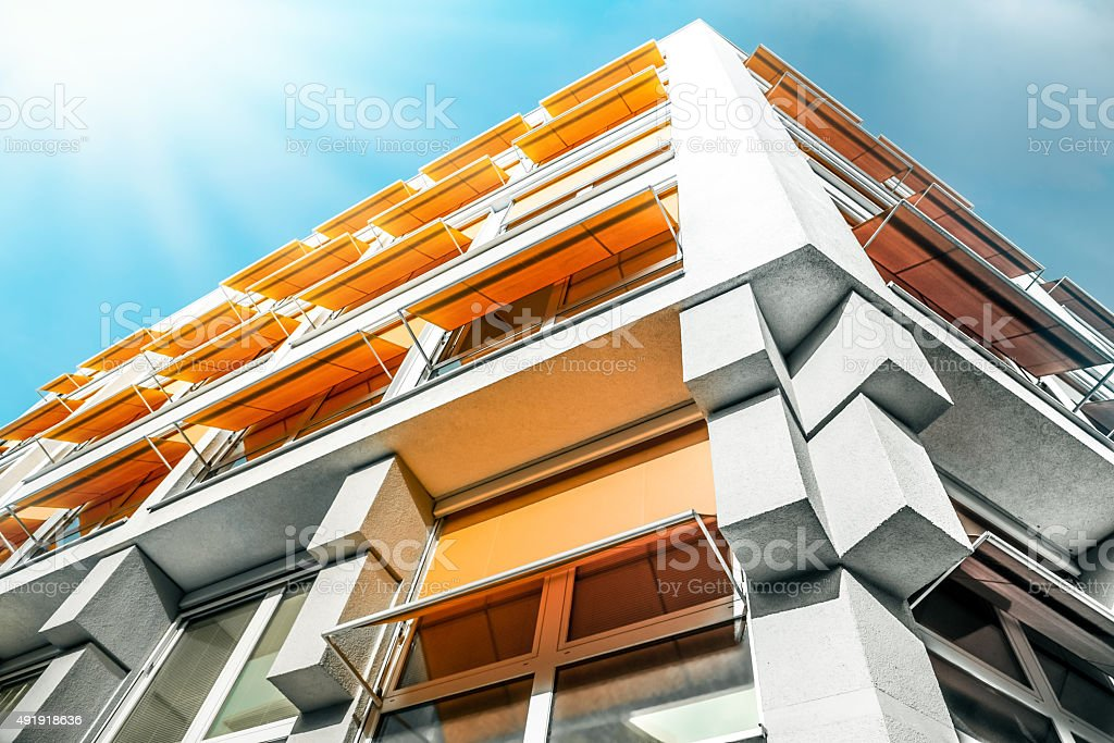 modern appartment house with orange sun protection stock photo