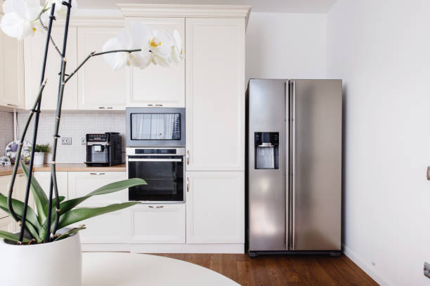 Modern appliances and new design in kitchen. Loft kitchen and apartment Modern appliances and new design in kitchen. Loft kitchen and apartment fridge stock pictures, royalty-free photos & images