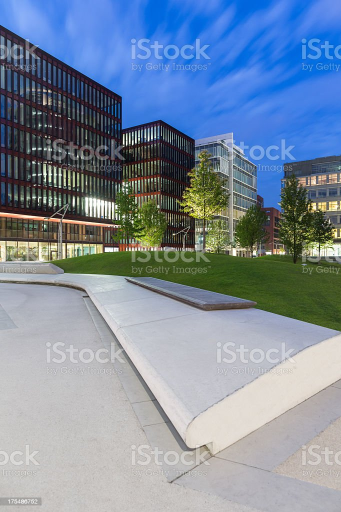 A modern architectural building with plants surrounding stock photo