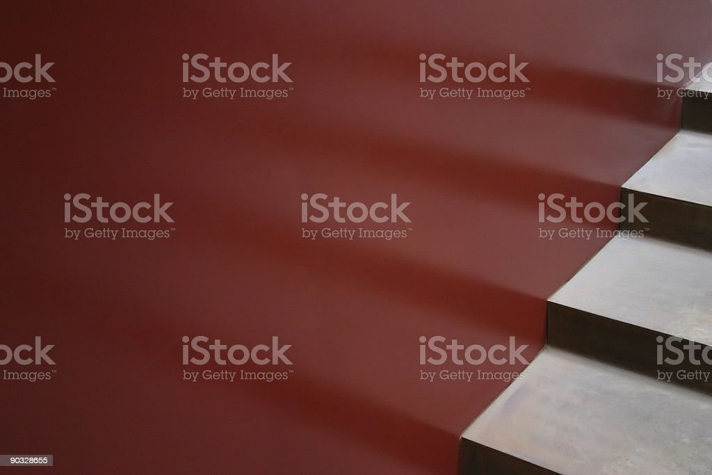 Modern Architectural stair treads and risers with reflection on red royalty-free stock photo