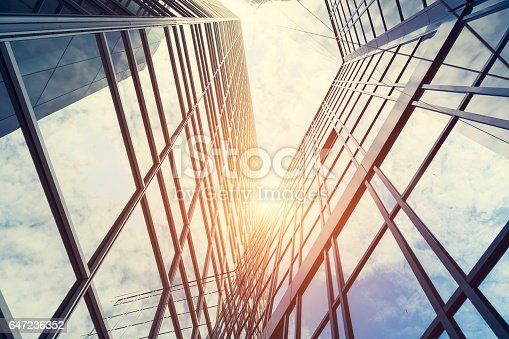 istock Modern architecture – double exposure 647236352