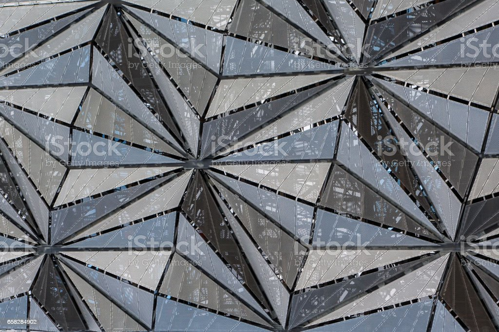 Modern architecture facade of grid panels in triangular pattern stock photo