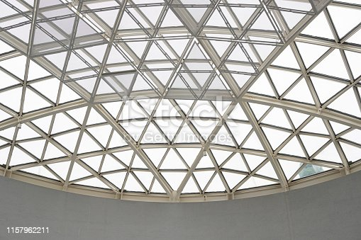 istock Modern architecture glass triangle window or roof building dome. 1157962211