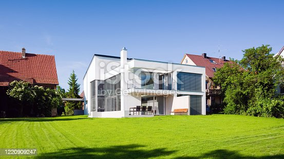 istock Modern Architecture Home Green On Green Summer Meadow 1220909247