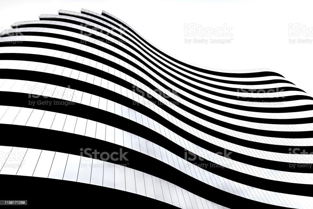 Modern architecture in Serbia. Waves facade design. Building in the shape of a flag. - Zbiór zdjęć royalty-free (Abstrakcja)